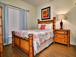 1st guest room has a comfy queen size bed.