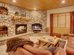 Spacious living room with flatscreen and fireplace