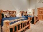 Bedroom - two queen beds with flatscreen