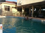 Relaxation by Poolside at Accra Serviced Villas.