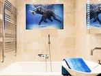 shared bathroom with bathtub