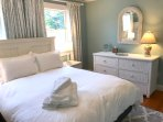 On the second floor this bedroom is equipped with a queen size bed and large walk in closet.