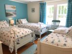 The third bedroom on the second floor has two twin beds and a day bed.