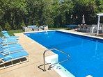 Plenty of seating options around the pool, including the comfortable seating around the gas fire pit.
