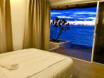 The spare bedroom with the view of the sea and sunset