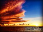 Beautiful cloud formation against the blue skies and the Sunset