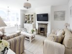 Lovely cosy living room with comfy sofas plus blankets & throws. There's a DAB radio USB charger