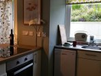 Small but perfectly formed kitchen with induction hob, oven, dishwasher, fridge and microwave