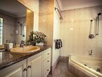 Master bedroom bath & spa with complimentary shower gel, shampoo & conditioner