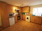 Well equipped kitchen includes electric cooker & washing machine