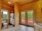 master bath with hot tub and shower