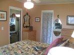main level queen bedroom has fantastic view & sound of beach ocean