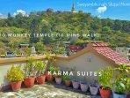 The main terrace looking towards the Swoyambhunath stupa and its lush greenery.