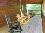 Enjoy a cold drink in the wooden swing or rocking chairs.