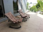 Relax in the rocking chairs and watch life pass by