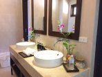 Complimentary daily water and bathroom amenities.