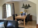 Living room extendable dining table with 6 leather seats.