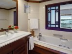 Ensuite Master bathroom with bath tub and view...