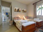 Third bedroom with 2 single beds with view on the lagoon