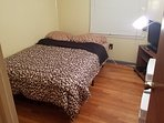 2nd upstairs bedroom features double bed with O.T.A. (over the air) digital  HDTV