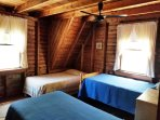Bedroom #2: Three single beds, ocean view.