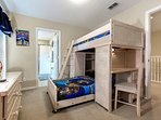 Themed children's bunk bed room with flat screen TV and en-suite bathroom.