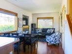 The open concept floorplan invites socializing, dining, and relaxing