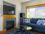 Enjoy a large flat screen TV and gas fireplace