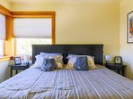 The master bedroom features a comfortable kind bed