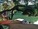 A plethora of lakefront adventures await you at this 2-bedroom, 1-bath Lake LBJ vacation rental cabin!