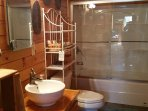 Main Bathroom at Big Rock Log Cabin With Shower/Bathtub, All Linens Are Provided.