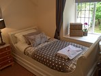 Beautiful single sleigh bed bedroom overlooking the private enclosed rear garden.