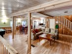 Hardwood floors and rustic wood beams create a warm environment throughout.