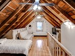 The loft upstairs offers 4 twin beds for additional sleeping arrangements.