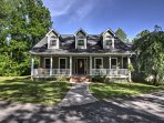 The home features a charming gabled roof and simple front, reflecting the Cape Cod-style homes.