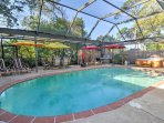 Complete with an outdoor, netted, swimming area with a pool and hot tub, this vacation rental studio ensures a...