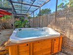 Enjoy relaxing in the soothing waters of the hot tub.