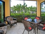 Your private lanai overlooks tropical gardens.