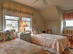 The kids will love sharing this room with 2 twin beds.