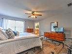 Unwind in this tranquil bedroom, offering a ceiling fan and flat-screen TV.