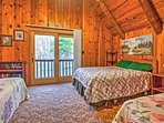 You'll feel like you're at camp when sharing this room with 3 full beds.