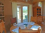 Round table dining with patio / mountain views.  Note distant 2nd round table for optional dining