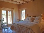King master bedroom with sweeping Taos Mountain / pasture views.