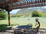 Inviting sun shaded patio with Taos Mountain views and the ever popular Southwest Native American fertility flute...