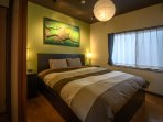 Super comfy Queen size bed in main bedroom ensures a great night's sleep.