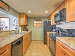 The fully equipped kitchen has all of the appliances and counter space you need to prepare meals.