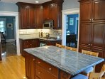 A fully equipped kitchen with stainless steel appliances makes cooking a joy.