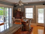 A 4-person informal dining room table sits beneath a cool ceiling fan.