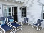 The outdoor deck features patio furniture for picnics and sun bathing.