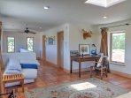 Sit in historic style at the antique desk on naturally warming Saltillo tile floors. .